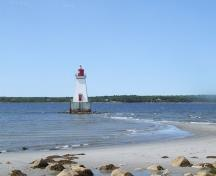 View of the Sandy Point Lighthouse, Shelburne, Nova Scotia, and the sand spit that it rests on.  It is only accessible by foot during lowtide.; Heritage Property Program, Nova Scotia Heritage Division, 2009