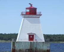 The door of the Sandy Point Lighthhouse, Shelburne, Nova Scotia, faces the shore for emergency purposes.; Heritage Property Program, Nova Scotia Heritage Division, 2009