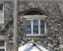 Featured is the leaded bay window with stained glass inset above.; Paul Dubniak, 2008.