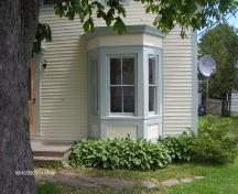 This photograph illustrates the single-storey bay window, 2009; Town of St. Andrews