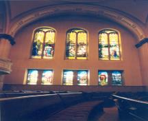 Interior view of the Erskine and American United Church National Historic Site of Canada, showing the Tiffany's religious stained glass windows, 1997.; Agence Parcs Canada / Parks Canada Agency, R. Goodspeed, 1997.