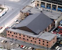 Aerial view of the armoury, showing its irregular plan and massing, consisting of two, two-storey blocks joined by a drill hall.; Regimental Museum.
