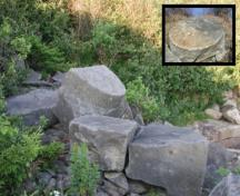 Remains of stones of the Beaumont Quarry consisting of two partially cut grindstones; Memramcook Valley Historical Society