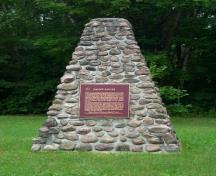 General view of the Historic Sites and Monuments Board of Canada plaque and cairn at Saint-Louis Mission, 2003.; Parks Canada Agency / Agence Parcs Canada, 2003.