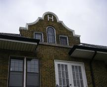 "Featured is one of the Dutch Renaissance gables, with letter ""H"".; Kayla Jonas, 2007."
