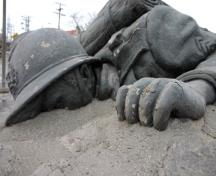 detail of the prone figure of the Belgian War Memorial, Winnipeg, 2006; Historic Resources Branch, Manitoba Culture, Heritage and Tourism, 2006