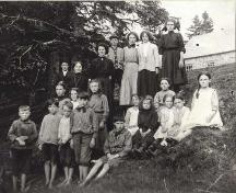 Class photo of students circa 1910 in front of the old school house, Cape George, NS.   ; Courtesy of the Antigonish Heritage Museum