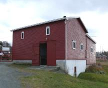 View of the front and right facades of Metcalfe Slaughter House and Barn, Chamberlains, Conception Bay South, NL. Photo taken 2009. ; HFNL/Andrea O'Brien 2009