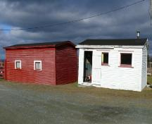 View of the right facade of Metcalfe Shed and the front facade of Metcalfe Office, Chamberlains, Conception Bay South, NL. Photo taken 2009. ; HFNL/Andrea O'Brien 2009