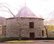 General view, showing the eight-sided conical roof, covered with cedar shingles and topped with a cross.; Parks Canada Agency / Agence Parcs Canada.