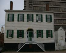 This photograph shows the contextual view of the house and the outbuilding; City of Saint John