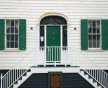 This image shows the transom, sidelights, wooden door and flanking windows; City of Saint John