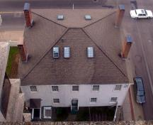 Aerial view showing the roof, the square massing and the symmetrical window arrangement on the rear façade; City of Saint John