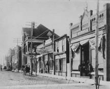 Archival view, from the northeast, of the Royal Canadian Legion (smaller building at left between two taller buildings), Carberry, ca. 1920; Carberry Plains Archives, ca. 1920