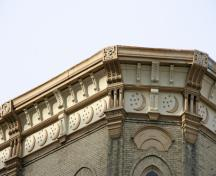 Detail view of the cornice of the Independent Order of Odd Fellows Hall, Winnipeg, 2007; Historic Resources Branch, Manitoba Culture, Heritage and Tourism, 2007