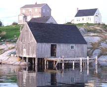 York Manuel Fish Shed and Store, fish store showing the dock and underpinning pilings, as well as the glacial rock upon which Peggy's Cove is built; Heritage Division, NS Dept. of Tourism, Culture and Heritage, 2008