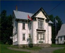 General view of Bolton-Est Town Hall, showing the wood frame construction and white painted clapboard siding.; Parks Canada Agency / Agence Parcs Canada.
