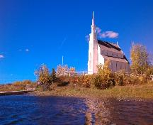"Upward view of Church on its prominent ""jutting out"" point onto the Churchill River.; Government of Saskatchewan, Calvin Fehr, 2004."