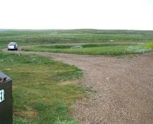 View southwest at rubbing stone and surrounding area, 2004.; Government of Saskatchewan, Michael Thome, 2004.