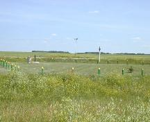 Looking southeast at Historic Site and cart tracks, 2004.; Government of Saskatchewan, Marvin Thomas, 2004.