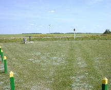Close-up view looking southeast at Historic Site and cart tracks, 2004.; Government of Saskatchewan, Marvin Thomas, 2004.