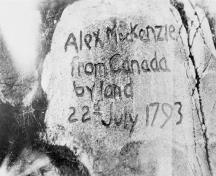 Detail view of the original inscription carved into the rock by Alexander Mackenzie in 1793 at the First Crossing of North America National Historic Site of Canada.; Bibliothèque et Archives Canada / Library and Archives Canada, C-003131.