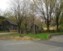 Of note is the Bradley House's setting beside the barn to the far left and drive shed.; Paul Dubniak, 2008.