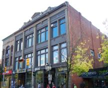 The McSweeney Building, fronting the south side of Main Street, retains most of the original exterior details.; Moncton Museum