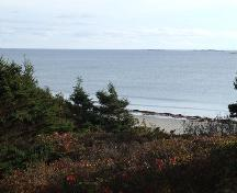 Clam Harbour Provincial Park looking out over the Atlantic Ocean through fir trees.; Heritage Division, NS Dept. of Tourism, Culture and Heritage, 2009.