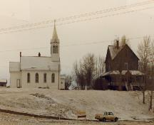 General view of the church and rectory of Notre Dame des Victoires / Lac La Biche Mission, 1988.; Historic Sites Service, Alberta Culture and Multiculturalism, 1988.