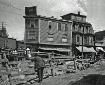 This historic photograph presents the excavation of Main Street to build the new Subway Structure.; Moncton Museum
