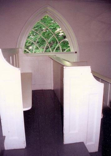 Showing balcony pews and Gothic window