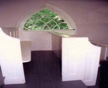 Showing balcony pews and Gothic window; Private Collection