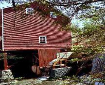 View of water wheel, building supports and a portion of dam, Balmoral Grist Mill, Balmoral Mills, NS, 2004.; Dept. of Tourism, Culture and Heritage, Province of NS, 2004
