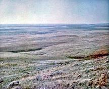 General view of British Block Cairn, showing its setting in a region of rolling mixed grass-prairie on the Great Plains.; Parks Canada Agency / Agence Parcs Canada, Harry A. Tatro.