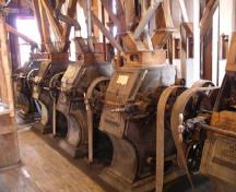 Interior view of the Esterhazy Flour Mill National Historic Site of Canada, showing five pairs of grinding roller units, 2007.; Agence Parcs Canada / Parks Canada Agency, A. Roos, 2007.