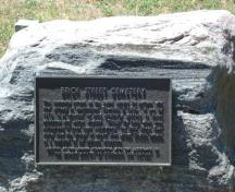 Featured is the plaque commemorating the early settlers who are interred at the cemetery.; Kendra Green, 2007.