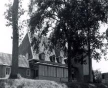General view of Caughnawaga Mission / Mission of St. Francis Xavier, showing its gabled dormers, 1966.; Canadian Inventory of Historic Buildings / Inventaire des bâtiments historiques du Canada, 1966.
