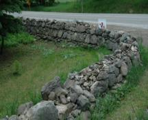 Featured is the dry stone fence, measuring 30 inches wide at base and 14 inches wide at top.; Sally Drummond, 2008.