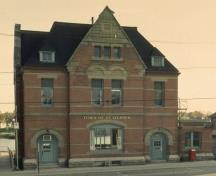 Façade of St. Stephen Post Office, showing its generous door and window trim, 1989.; Parks Canada Agency / Agence Parcs Canada, 1989.