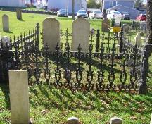 A family burial plot surrounded by a wrought iron fence in Zion United Church Cemetery, Liverpool, Queens County, NS.; NS Dept. of Tourism, Culture & Heritage, 2009