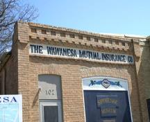 View of the signage on the original building of the Wawanesa Mutual Insurance Company Building, Wawanesa, 2005; Historic Resources Branch, Manitoba Culture, Heritage and Tourism, 2005
