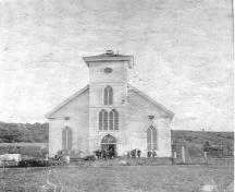 Shows the aftermath of a lightning strike and fire which destroyed the steeple of the church, St. Margaret's Church, Arisaig, Antigonish County.; Photo courtesy of Antigonish Heritage Museum.