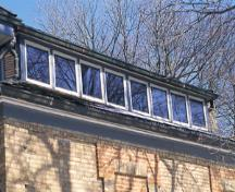 View of the exterior of Homer Watson House / Doon School of Fine Arts, showing the clerestory windows and a monitor, which allow for soft, indirect light, 1995.; Parks Canada Agency / Agence Parcs Canada, J. Butterill, 1995.