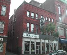 This contextual photograph shows the building with an alleyway to the north and the Masonic Temple to the south, 2004.; City of Saint John