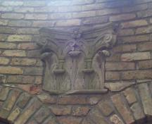 Featured is one of the salvaged stone capitals.; City of London, Planning and Development Department, 2004.