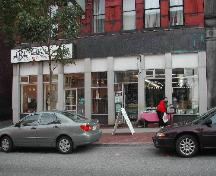 This photograph shows the storefront with the large fascia band and heavy pillars, 2004.; City of Saint John