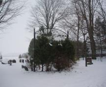 Of note are the mature trees and cemetery sign.; Martha Fallis, 2008.