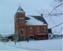 Of note are the paired windows in the tower.; Municipality of Huron East, 2008.