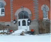 Featured is the entrance with stained glass transom.; Municipality of Huron East, 2008.